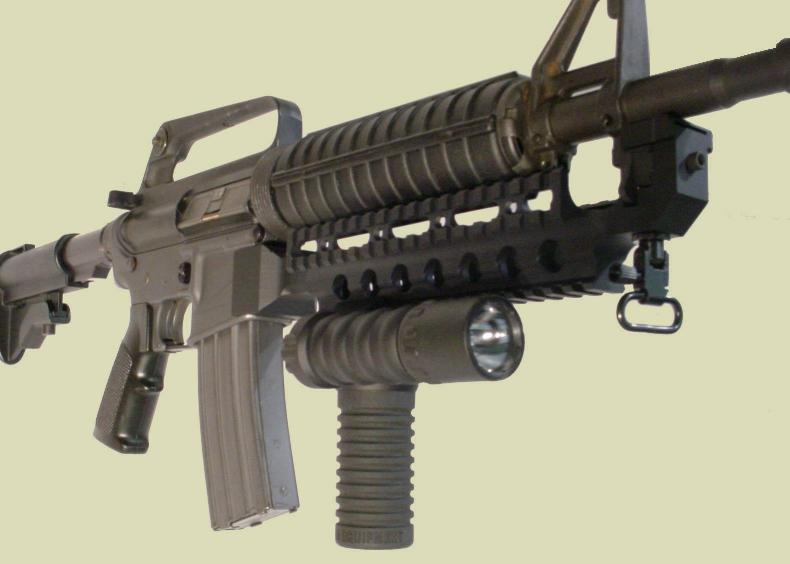 M4 rifle with the RM Rail Grip with the Tactical Light mounted to the Fast Rail.