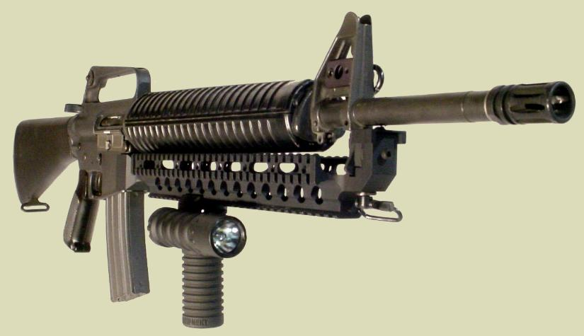 M16 rifle with the Fast Rail holding the RM Rail Grip with the Tactical Light.